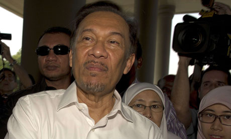 Anwar Ibrahim arrives in court in Kuala Lumpur. He told reporters: 'It is clearly a politically motivated charge.