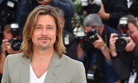 Brad Pitt poses at the Killing Them Softly photocall in Cannes