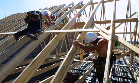 workers build roof