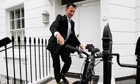 Jeremy Hunt hops on bicycle outside London home