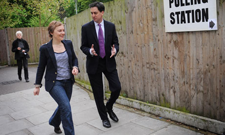 Labour leader Ed Miliband and his wife Justine arrive at their local polling station on 3 May 2012.