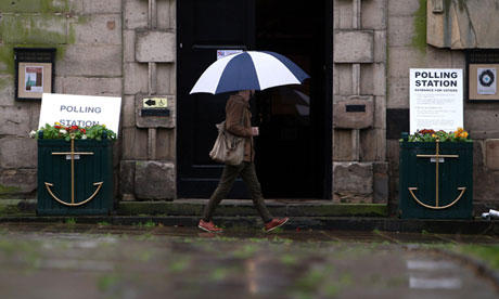 A man walks past a polling station in Birmingham on 3 May 2012.