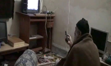 Still image from a video shows al-Qaida leader Osama bin Laden watching TV in his Pakistan compound