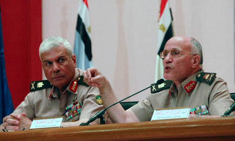 Egypt's Major General Mokhtar al Molla (L) and Major General Mohammed al-Assar