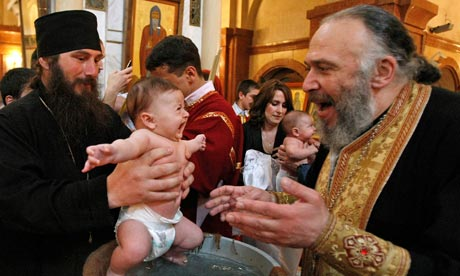 Georgian babies are baptised at the Holy Trinity cathedral in Tbilis by Patriarch Ilia II. Photograph: Shakh Aivazov/AP