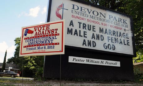 Signs display messages about gay marriage in North Carolina.