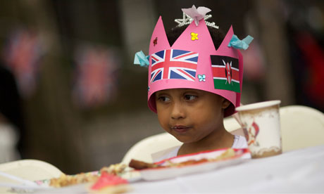 a child wears a paper crown