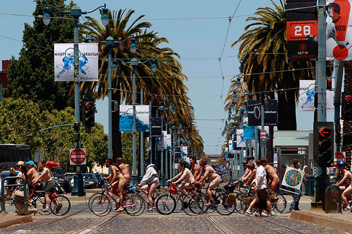 Nude Cyclists: California, US: A group of naked cyclists cross an intersection