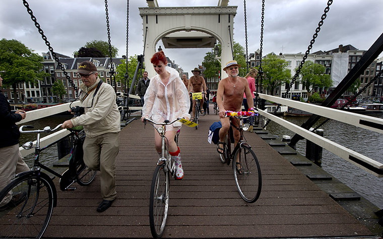 Nude Cyclists: Amsterdam, The Netherlands: Dutch cyclists take part in the naked ride