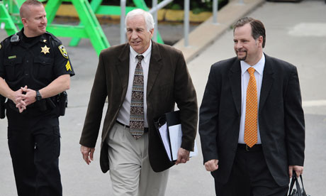 Jerry Sandusky, center, leaves court after jury selection last week.