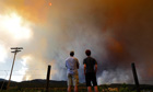 People watch as smoke and flames encroach upon homes and ranches near Laporte, Colorado