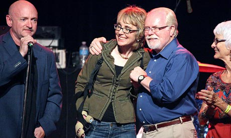 Mark Kelly, Gabrielle Giffords, Ron Barber and Nancy Barber gather ...