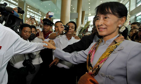 Aung San Suu Kyi arrives at Yangon airport in Burma to depart for Europe