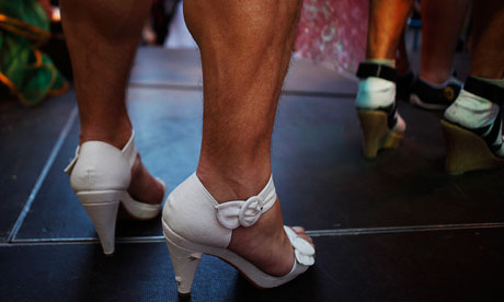 Contestants stand on the stage after the annual race on high heelsin Madrid