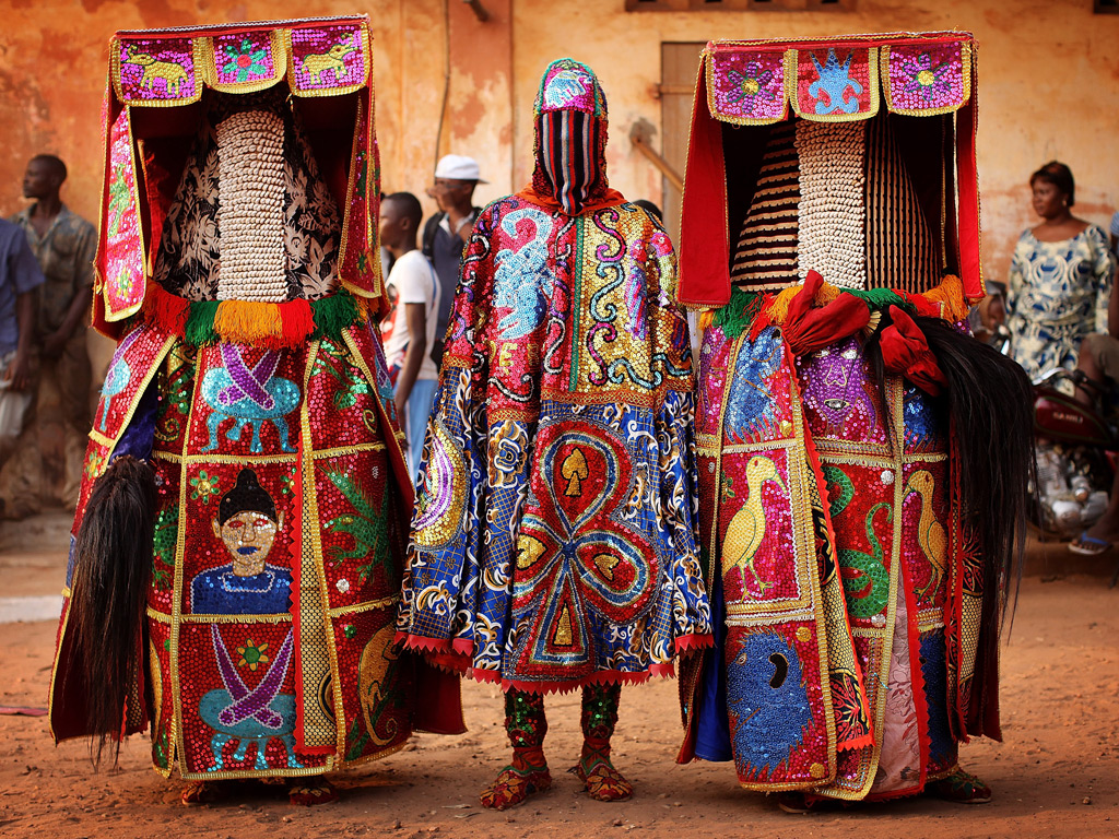 Voodoo 'spirits' perform at a ceremony in Ouidah, Benin