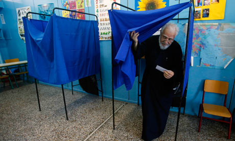 Father Christos exits a voting booth at an Athens primary school on 17 June