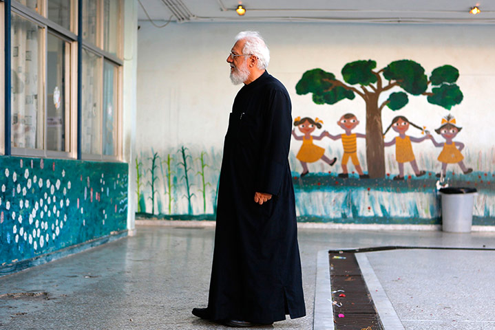Greek elections: A Greek Orthodox priest waits to vote in Athens