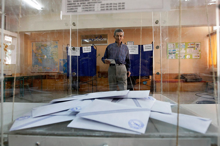 Greek elections: A man walks to cast his ballot in a polling station in Athens
