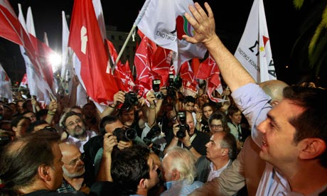 Head of Greece's radical left SYRIZA party Tsipras waves to supporters in Athens
