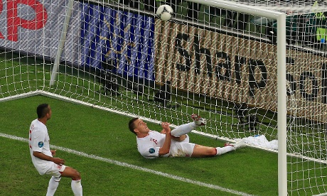 John Terry attempts to clear the ball from Marko Devic's shot
