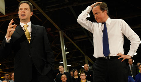 Prime Minister David Cameron listens to Deputy Prime Minister Nick Clegg during a meeting