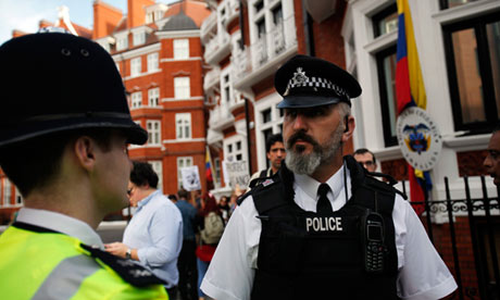 Police and protesters outside the Ecuadorean embassy in London, where Julian Assange has sought asylum. Photograph: Karel Prinsloo/EPA