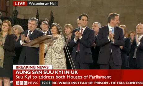 Gordon Brown, Ed Miliband and David Cameron applauding Aung San Suu Kyi