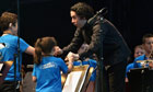 Gustavo Dudamel with two of the Big Noise Orchestra