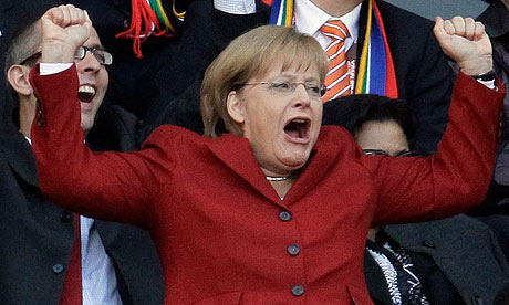 Angela Merkel celebrates a German goal at the 2010 World Cup