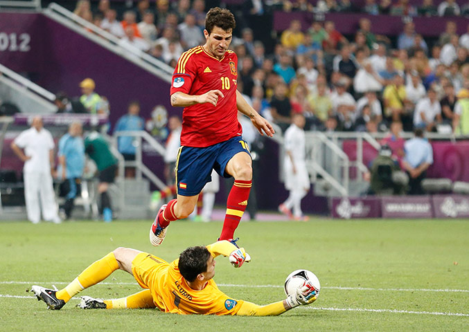 Spain v France 2: France's Lloris makes a save in front of Spain's Fabregas