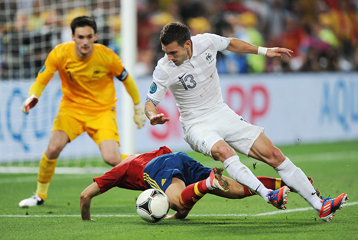Spain v France 3: Anthony Reveillere of France challenges Pedro