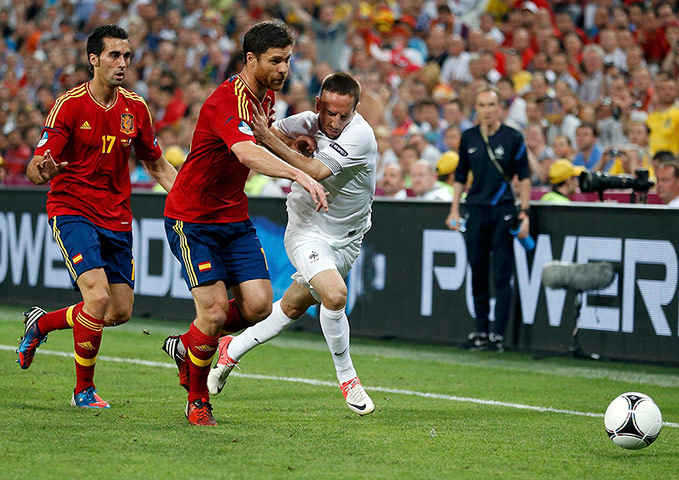 Spain v France 3: France's Ribery is challenged by Spain's Arbeloa and Alonso