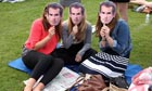 Tennis fans hold Andy Murray masks while waiting to buy tickets for day two of Wimbledon