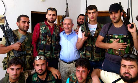 Syrian National Council leader Burhan Ghalioun  poses  with Syrian free army in Sarmada