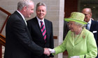 Queen Elizabeth shakes hands with Martin McGuinness