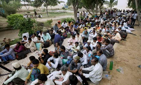 Indian fishermen waiting for transport after being released from jail in Pakistan