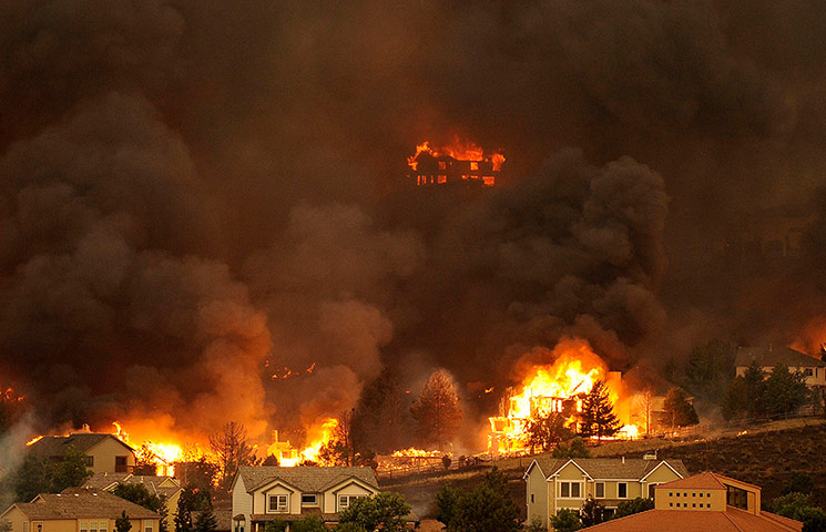Wildfires in Colorado: The Waldo Canyon fire burns an entire neighborhood of Colorado Springs
