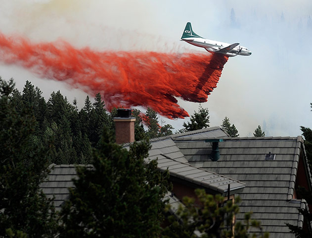 Wildfires in Colorado: A tanker drops fire retardant while fighting the Flagstaff fire in Boulder