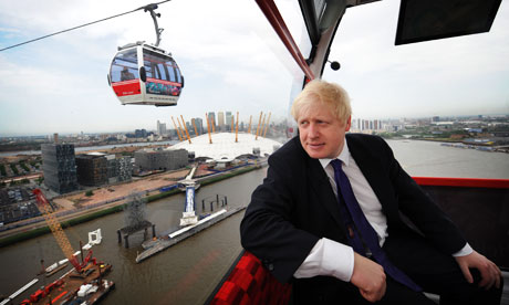 London mayor Boris Johnson rides on the Emirates Air Line cable car across the Thames in London