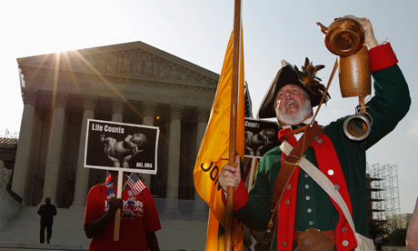 Tea party supporter Temple shouts against the healthcare overhaul outside the Supreme Court