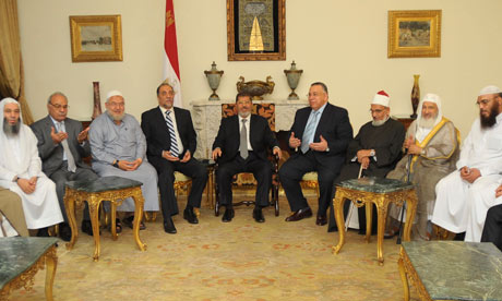 Egypt's President-elect Mohamed Morsi meets with the heads of Egyptian Islamic movement
