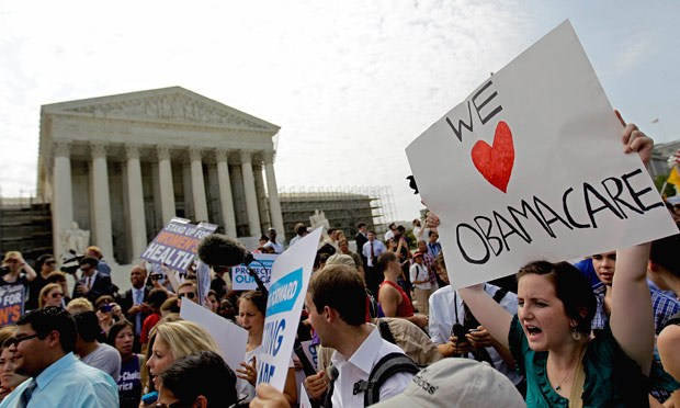 Supporters of President Barack Obama's health care law celebrate outside the Supreme Court