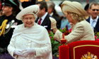 Queen Elizabeth: silly hats in the rain salute mistress of radiant smile