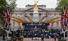 Workers prepare the stage for the diamond jubilee concert in front of Buckingham Palace
