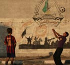 Palestinian boys play football 