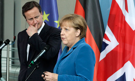 David Cameron and Angela Merkel in Berlin on 7 June 2012.
