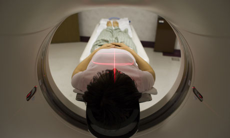 A female patient getting a CT scan
