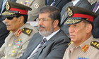 Egypt: Morsi's showdown with the military put on hold - live updates