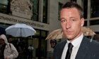John Terry leaves the second day of his trial for racially abusing Anton Ferdinand