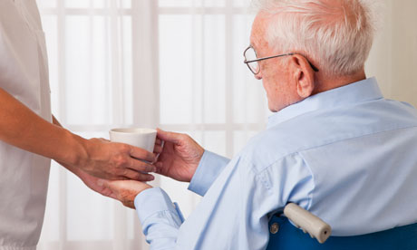 elderly man in a wheelchair in care home care home residential care